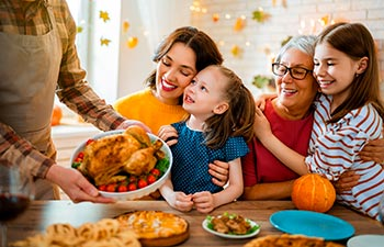 Family sitting at the table and celebrating holiday