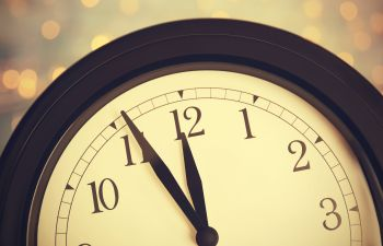 Clock counting down last minutes to New Year.